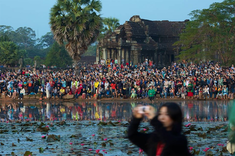Sunrise at Angkor Wat is not tranquil time!